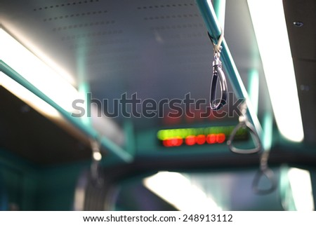 Safety in public transport, triangular handles - stock photo