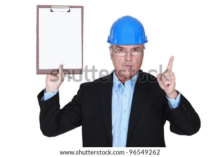 Safety inspector with clipboard - stock photo