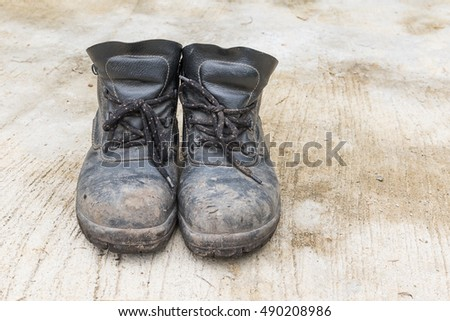 Safety leather man shoe on the cement floor texture background