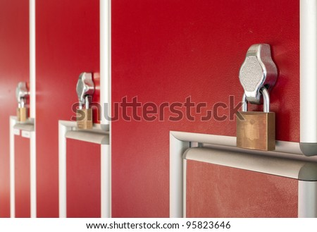 safety locks on red industrial metal lockers - stock photo