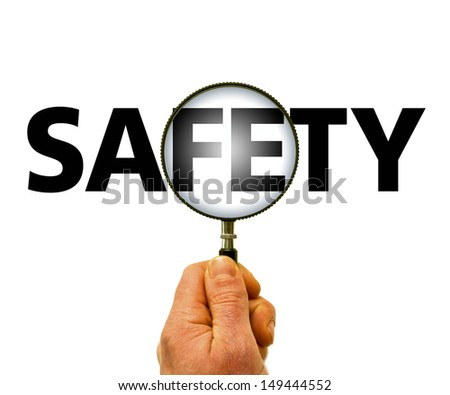 Safety magnifying glas - stock photo