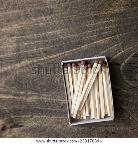 safety matches on wooden table, from above - stock photo