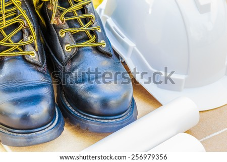 safety shoe and safety helmet Close up - stock photo