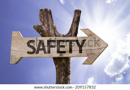 Safety wooden sign on a beautiful day - stock photo