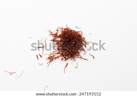 Safron is a valuable herbs mostly found in arabic country. Saffron has many benefits towards health.By mixing a few saffron with hot water, the water will turn color into yellow. - stock photo