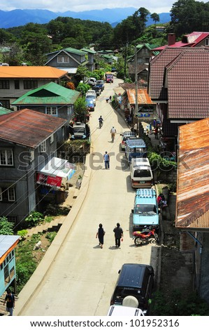 """SAGADA, PHILIPPINES - MARCH 27: Aerial view on the street on March 27, 2012 in Sagada, Philippines. Sagada - is located 275 km from Manila. It is famous tourist destinations for its """"hanging coffins"""" - stock photo"""