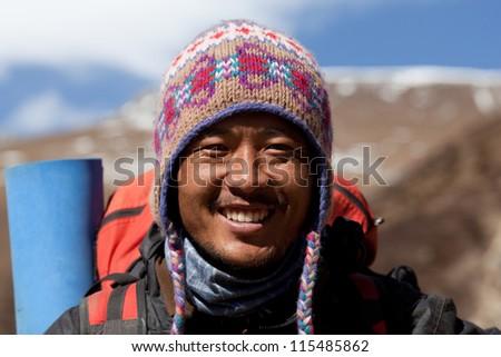 SAGARMATHA NATIONAL PARK, NEPAL - DECEMBER 01: Dendi Sherpa, trekking guide at the pass in time of Russian expedition on December 01, 2009 in Sagarmatha National Park, Nepal Himalaya - stock photo