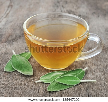 sage leaves and sage tea on wooden tables