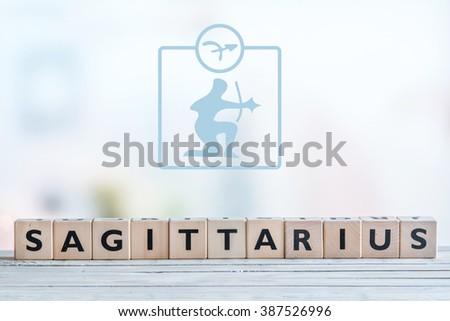 Sagittarius star sign on a wooden table - stock photo