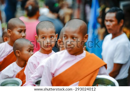 SAGKLABURI  KANCHANABURI THAILAND - October 19: Portrait of a young Burmese Buddhist nun on October 19, 2014 in Sagklaburi  . Burmese Buddhist nuns are called Bhikkhuni and they wear pink robes. - stock photo