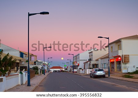 SAGRES, PORTUGAL - JANUARY 04,2016: Portugal village at twilight in Sagres, Algarve region - the most popular tourist destination in Portugal. Almost 10 million people visit the Algarve annually. - stock photo
