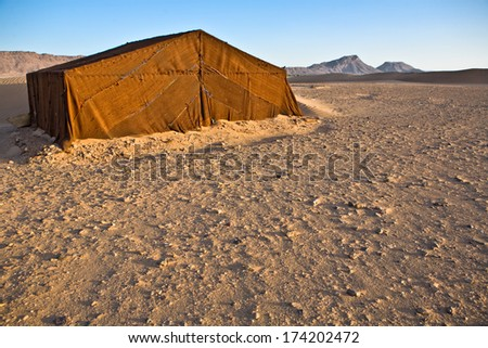 Sahara desert doors area scene with fabric tent on the sand, Zagora, Morocco - stock photo