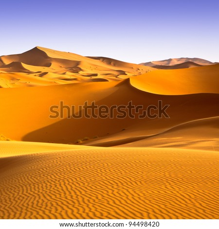 Sahara desert landscape with blue sky. Dunes background. - stock photo