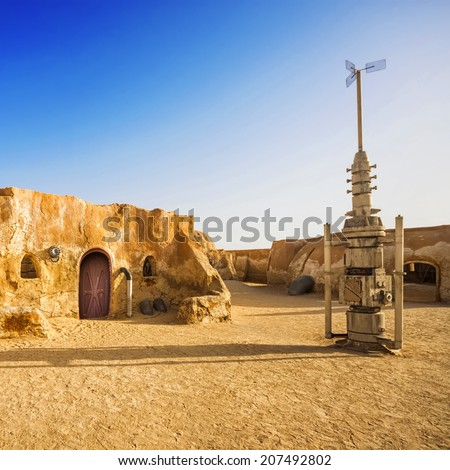 SAHARA, TUNISIA - JUL 10: Abandoned sets for the shooting of the movie Star Wars in the Sahara desert on a background of sand dunes on July 10, 2012 in Sahara, Tunisia  - stock photo