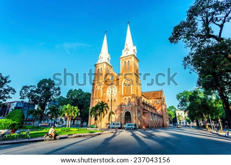 SAIGON NOTRE DAME BASILICA, HCMC, VIETNAM - NOVEMBER 6, 2014 - The outside peaceful scenery early morning. The cathedral was constructed between 1863 & 1880 and is a very famous building in HCMC. - stock photo