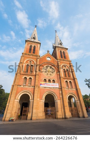 Saigon Notre Dame Basilica on Tet Eve. Established by French colonists, the cathedral was constructed between 1863 and 1880. - stock photo