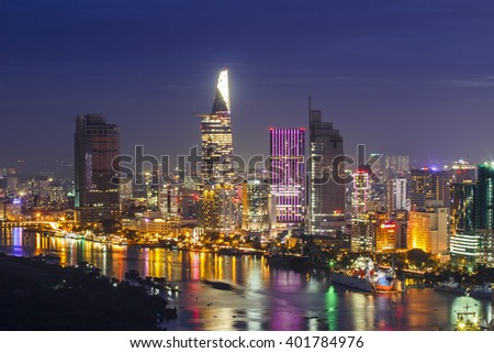 SAIGON, VIETNAM - DEC 20, 2014 : Impression landscape of Ho Chi Minh city at night , Saigon river flows through the city, this photo was taken at Sai Gon pearl building.