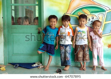 SAIGON, VIETNAM - JULY 11 : Hieu,4, Thao,4, Tung,4, and Thuy,3 from Ho Chi Minh City having their first day at National Kindergarden No.4 in Saigon, Vietnam, on July 11, 2010. - stock photo
