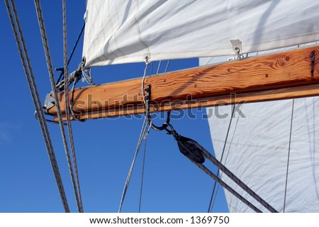 Sail and boom, landscape  view - stock photo