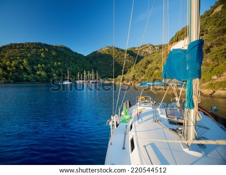 Sail boat anchored in a calm blue water bay of Skopea Limani. Turkey - stock photo