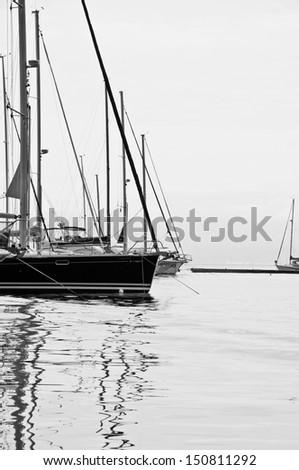 Sail boat at the marina. Black and white  - stock photo