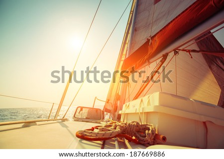 Sail boat in an open sea at sunny day - stock photo