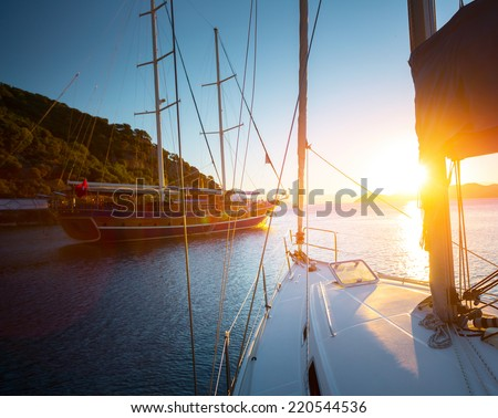 Sail boats anchored in a calm blue water bay of Skopea Limani. Turkey - stock photo