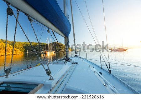 Sail boats anchored in the calm bay of Skopea Limani, Turkey - stock photo