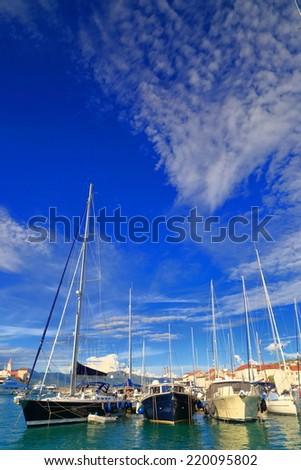 Sail boats anchored on a pier near the Adriatic sea, Trogir, Croatia - stock photo