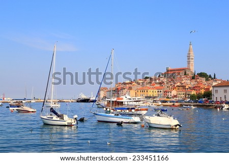 Sail boats at anchor in the harbor of old Venetian town, Rovinj, Croatia - stock photo