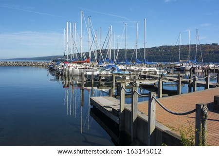 Sail boats at the boat marina at the southern end of Seneca lake in Watkins Glen New York on a beautiful blue sky day in autumn. - stock photo