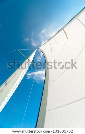 Sail of a sailing boat against sky - stock photo