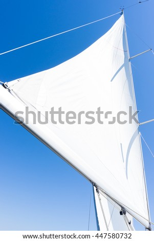 sail of a sailing boat. sailing yacht on the water - stock photo