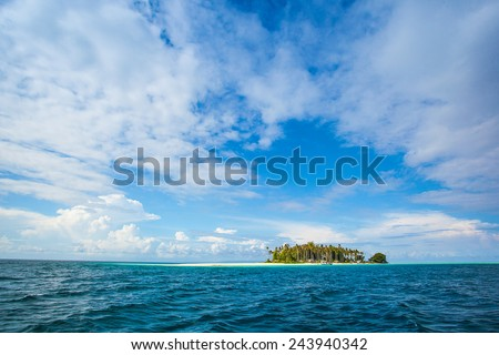 sail to an island that is still far off but it looks very beautiful island with natural scenery - stock photo
