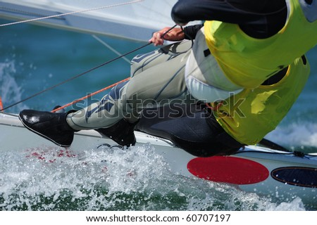 Sailboarder gliding across the ocean on their sailboard - stock photo