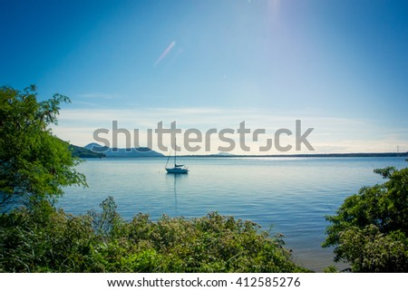 Sailboat at Lagoa da Conceicao, Florianopolis, Brazil - stock photo