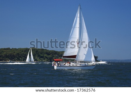 Sailboat beating into the wind on a windy day. - stock photo