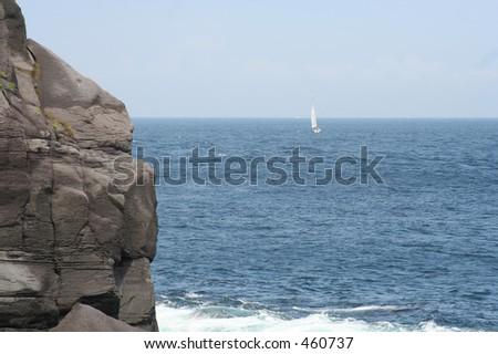 Sailboat departing - stock photo