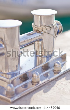 Sailboat detailed parts, close up on winch and rope of yacht - stock photo