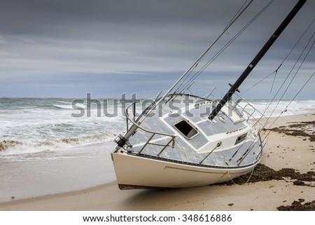 Sailboat Grounded on a Sandy Beach - Cape Canaveral National Seashore, Merritt Island, Florida - stock photo