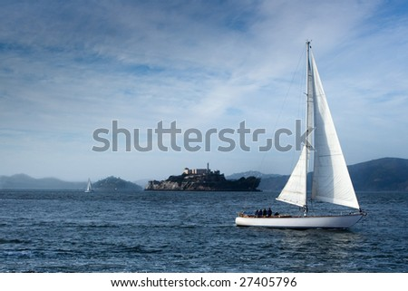 Sailboat in front of Alcatraz island in San Francisco bay - stock photo