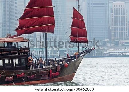 sailboat in Hong Kong harbor - stock photo