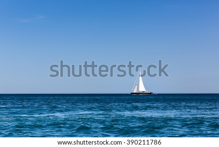 Sailboat in the ocean - stock photo
