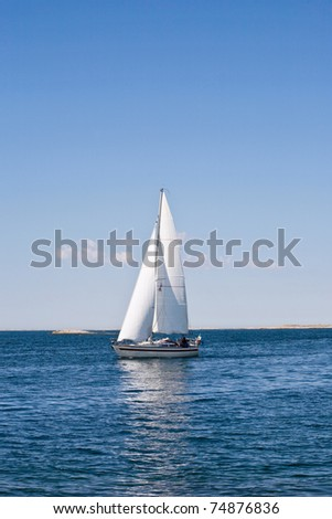 Sailboat in the sea one summer day - stock photo