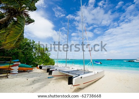 sailboat laying on the maldives island beach - stock photo