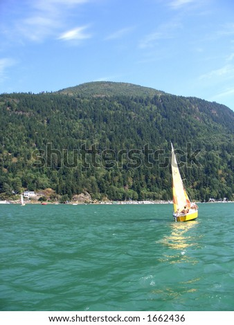 Sailboat on a clear summer day - stock photo