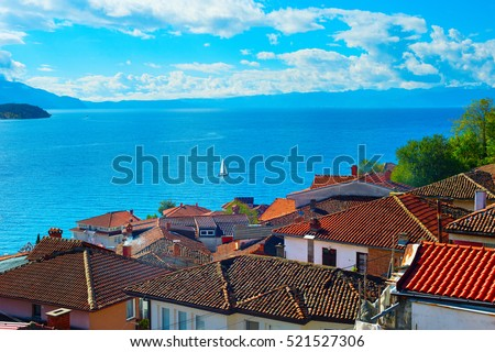Sailboat on a lake Ohrid. Old town roofs on the foreground. Macedonia