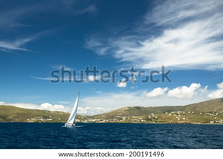 Sailboat on peaceful still waters in a harbor. - stock photo
