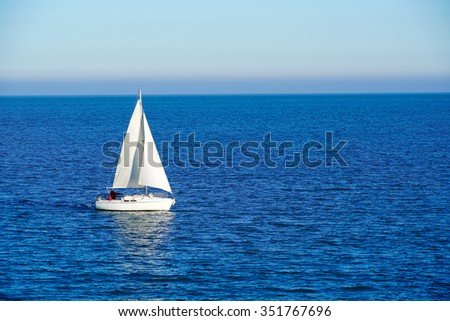 sailboat on the blue ocean in the sunshine