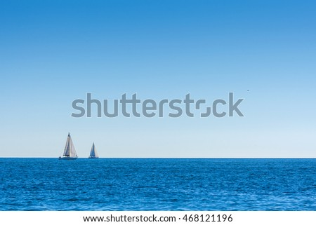 Sailboat on the blue ocean in the sunshine. Calm weather. Romantic magical summer.